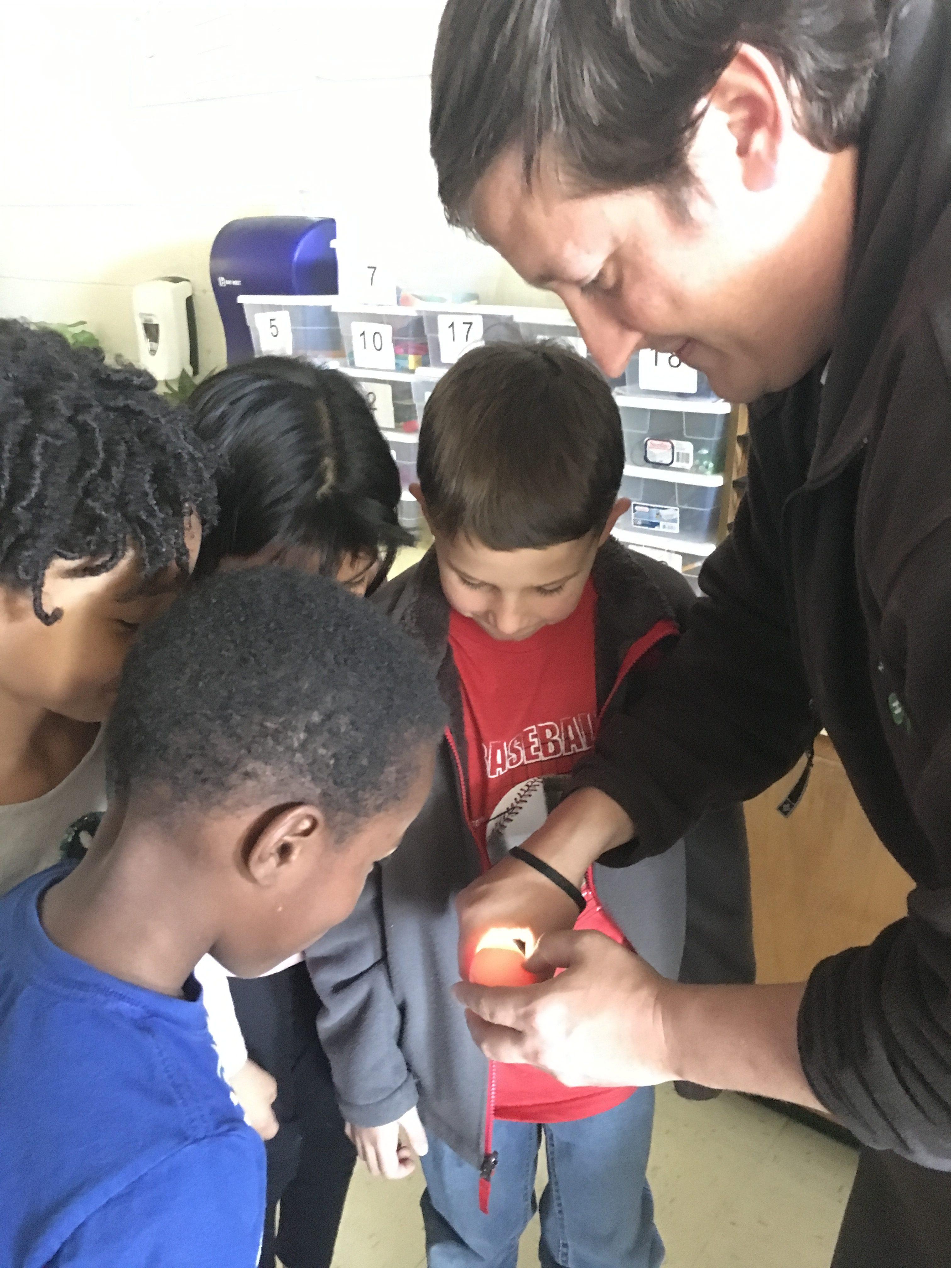 Kids looking at egg